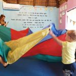 Why does Toptots have a parachute programme?